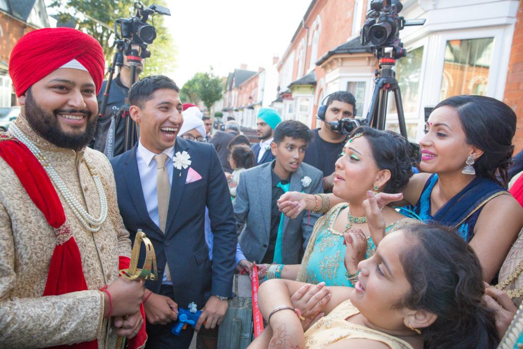 indian wedding groom arriving home