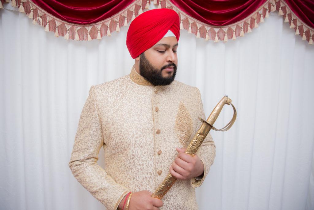 indian groom getting ready sword