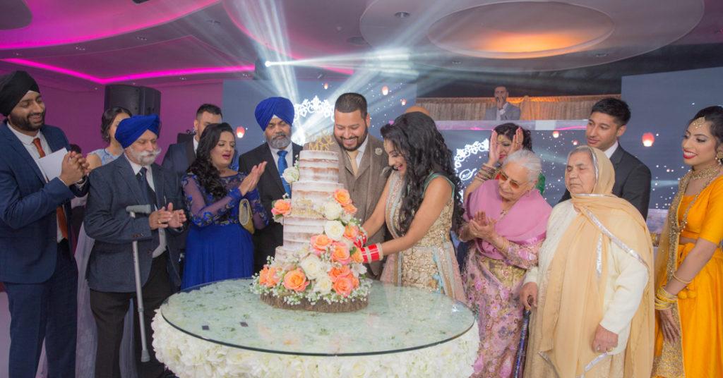 Bride groom reception party cut cake