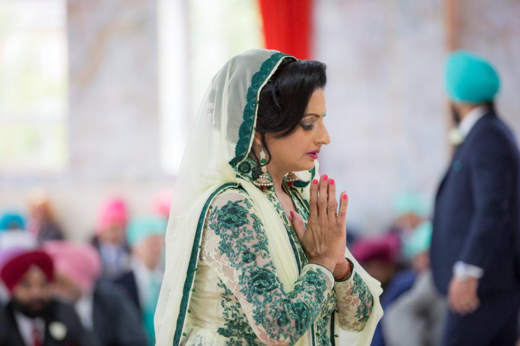 sikh wedding mother praying