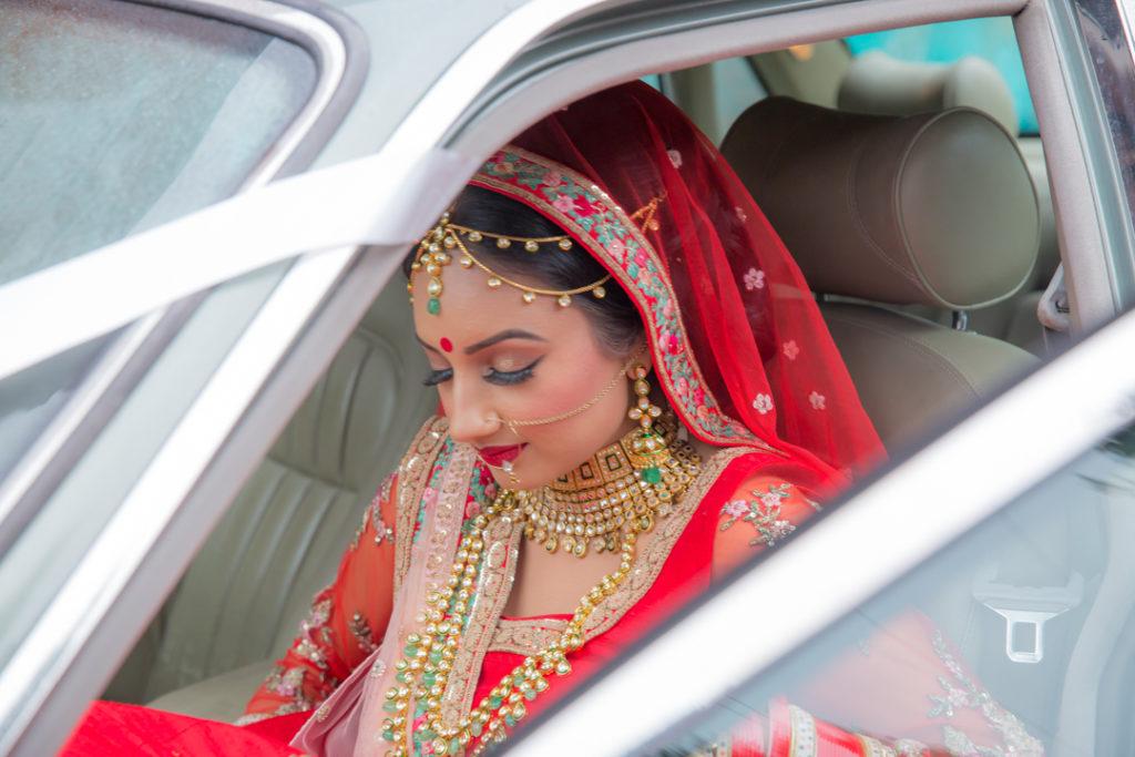 indian bride getting into car