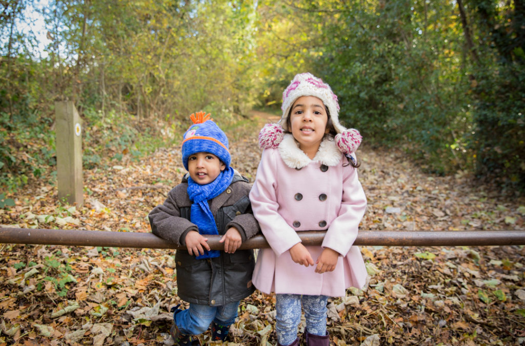 children photoshoot mother father parents autumn leaves outdoor