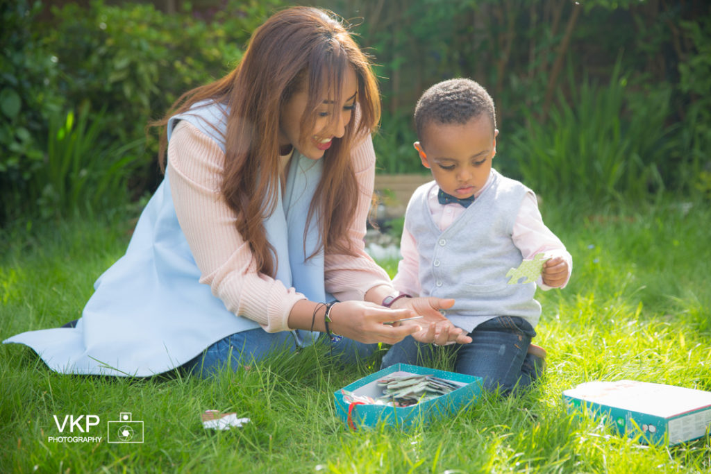 family photoshoot mother father parents toddler outdoors garden